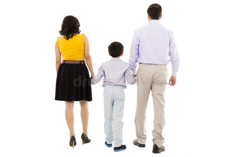 Família que anda afastado no estúdio foto de stock royalty free
