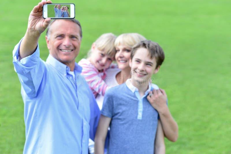 Família que captura sua apreciação imagem de stock