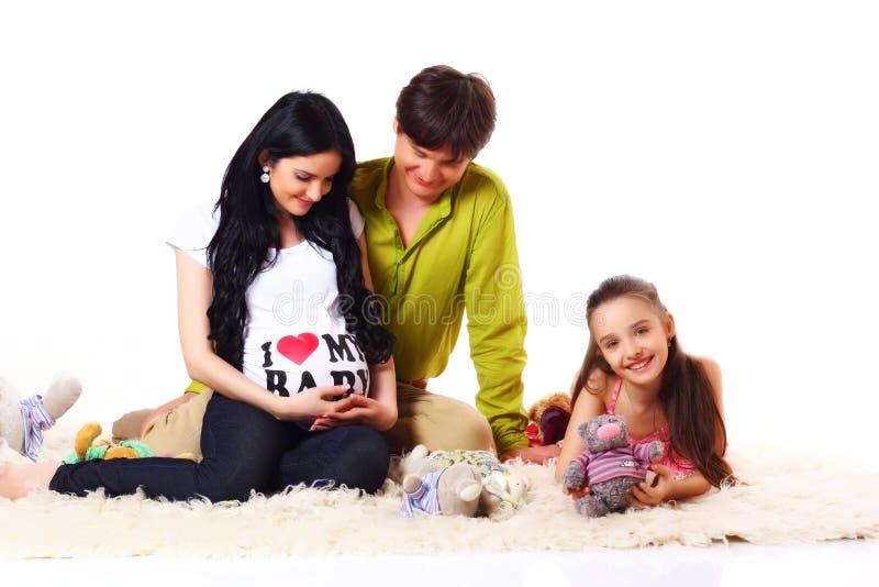 Família que espera o bebê imagens de stock royalty free