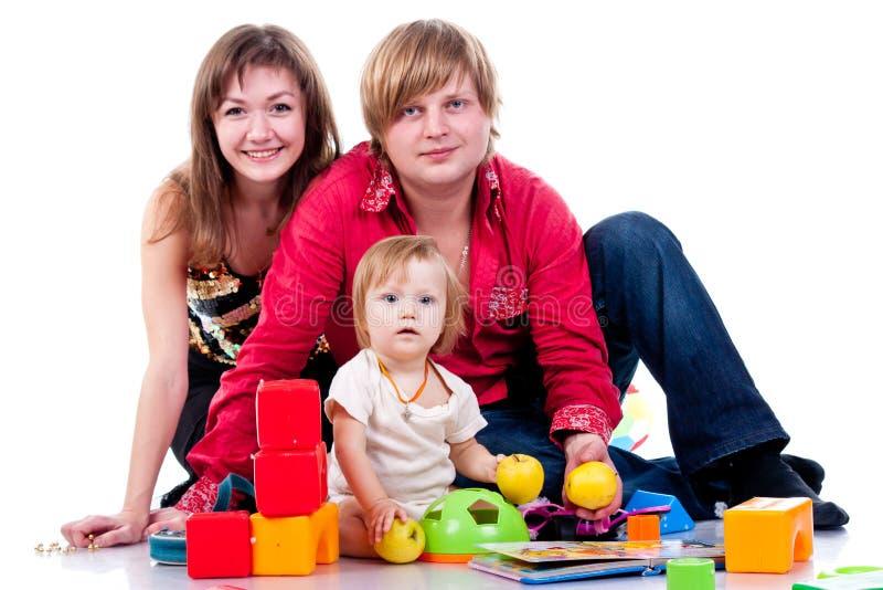Família que joga com brinquedos foto de stock royalty free