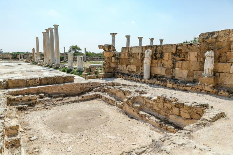Famagusta, Turkish Republic of Northern Cyprus. Columns and sculptures at Ancient City Salamis Ruins. Famagusta, Turkish Republic of Northern Cyprus. Corinthian royalty free stock photo