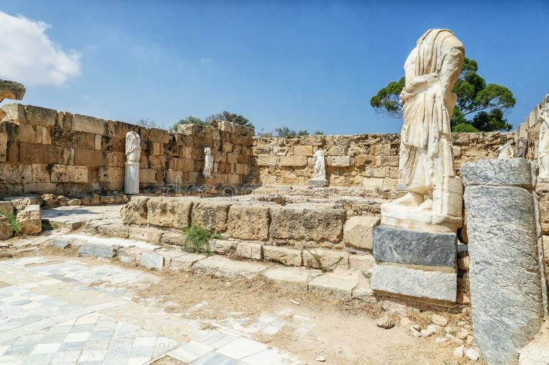 Famagusta, Turkish Republic of Northern Cyprus. Columns and sculptures at Ancient City Salamis Ruins. Famagusta, Turkish Republic of Northern Cyprus. Corinthian stock photography