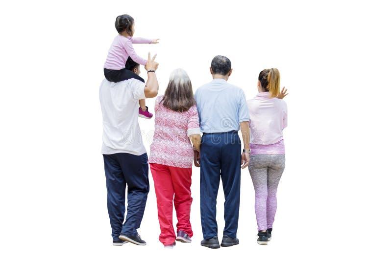 Famiglia allargata che cammina insieme nello studio fotografia stock