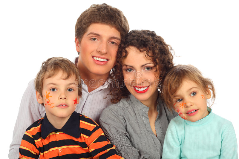 Famiglia con le pitture sui fronti puerili fotografia stock libera da diritti