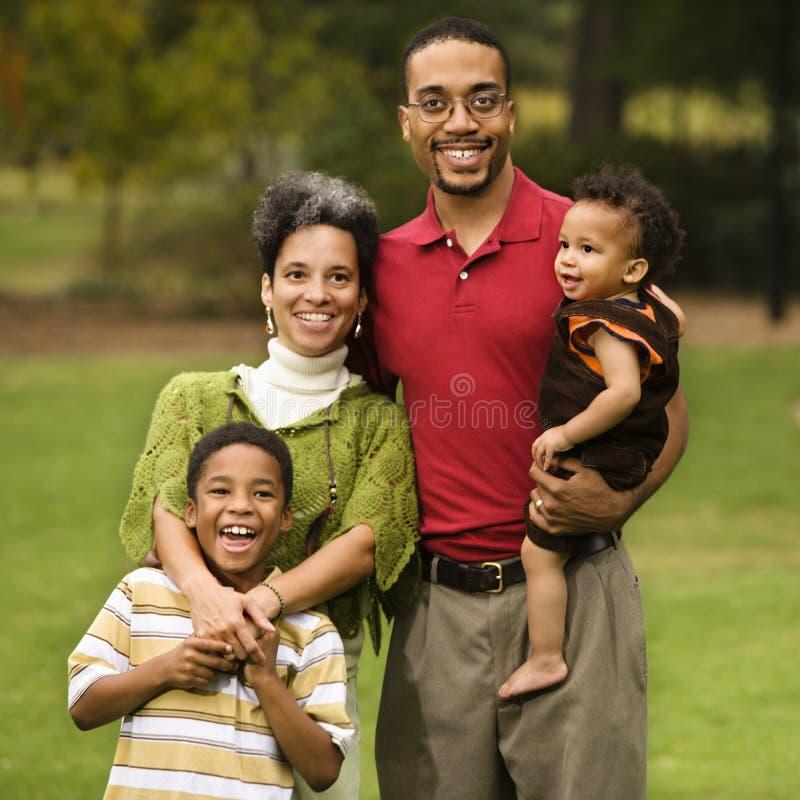 Famiglia di quattro immagine stock