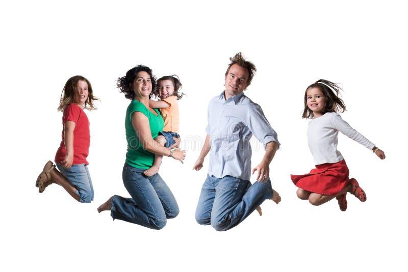 Famiglia di salto immagine stock
