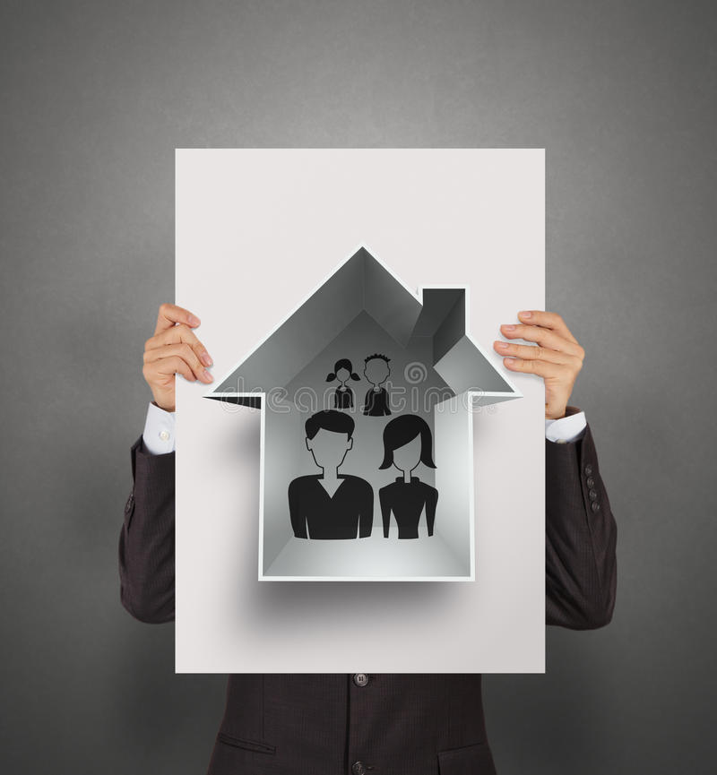 Famiglia e casa di tiraggio della mano di manifestazione dell'uomo d'affari fotografia stock libera da diritti