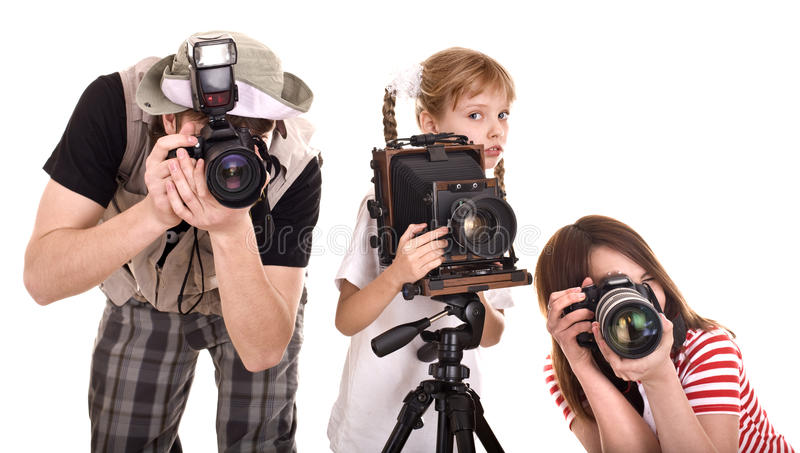 Famiglia felice con la macchina fotografica del gruppo. fotografie stock libere da diritti