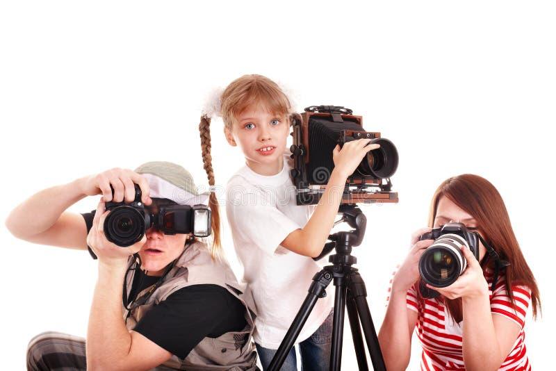 Famiglia felice con la macchina fotografica del gruppo. fotografia stock