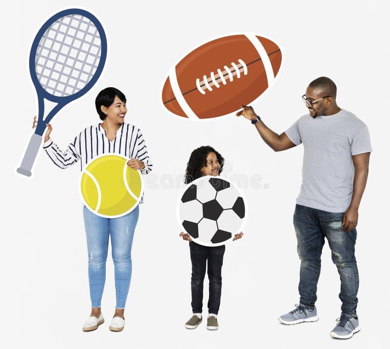 Famiglia felice con le icone di sport fotografia stock