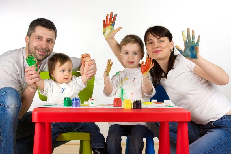 Famiglia felice della pittura immagini stock
