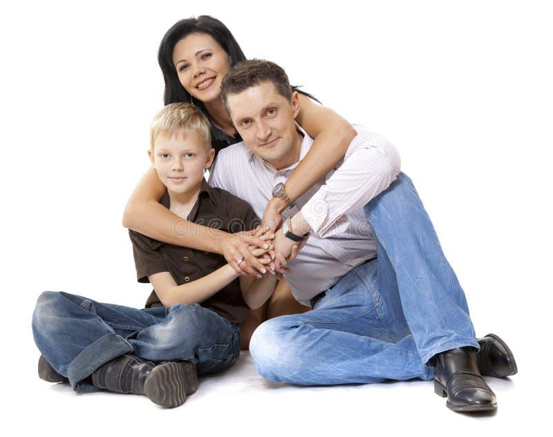 Famiglia felice in studio immagine stock