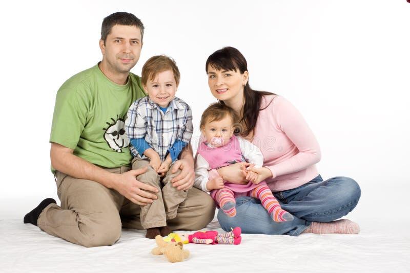 Famiglia felice su bianco fotografia stock