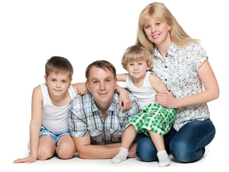 Familia de cuatro miembros imagen de archivo