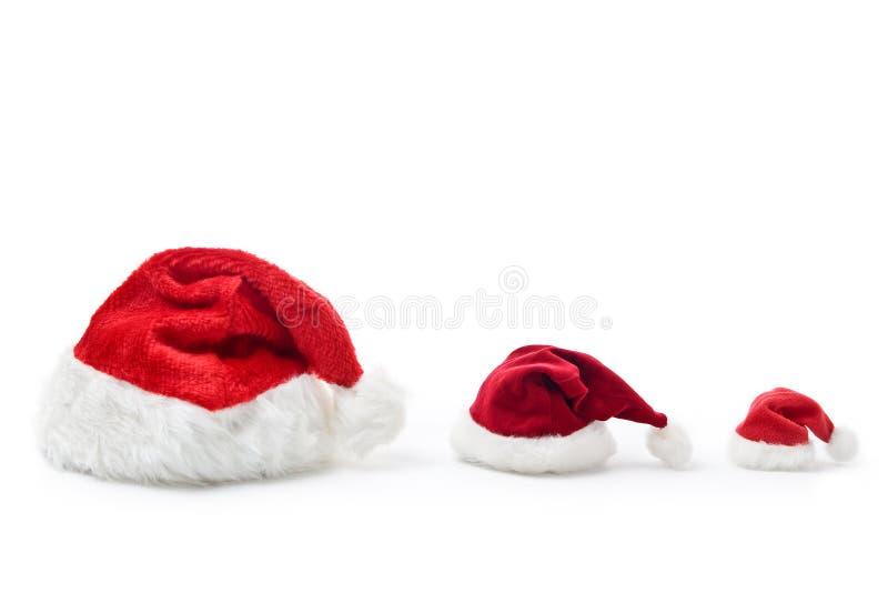 Familia del sombrero de la Navidad fotos de archivo libres de regalías