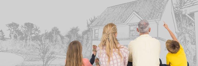 Familia delante del bosquejo del dibujo de la casa imagen de archivo