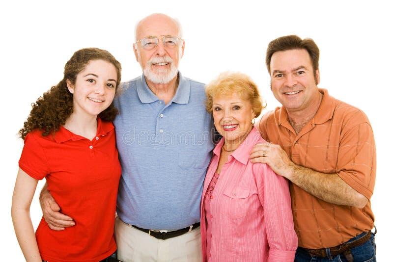 Familia extensa sobre blanco imagenes de archivo