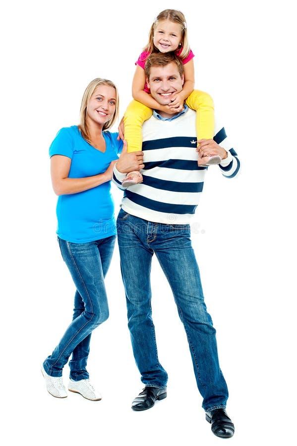 Familia feliz. Padre, madre y muchacha imágenes de archivo libres de regalías