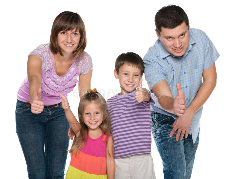 Familia feliz que detiene sus pulgares fotografía de archivo libre de regalías