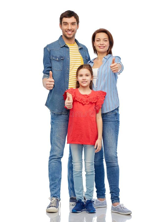 Familia feliz que muestra los pulgares para arriba fotografía de archivo libre de regalías