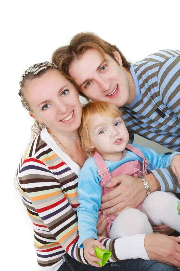 Familia feliz sobre blanco imágenes de archivo libres de regalías