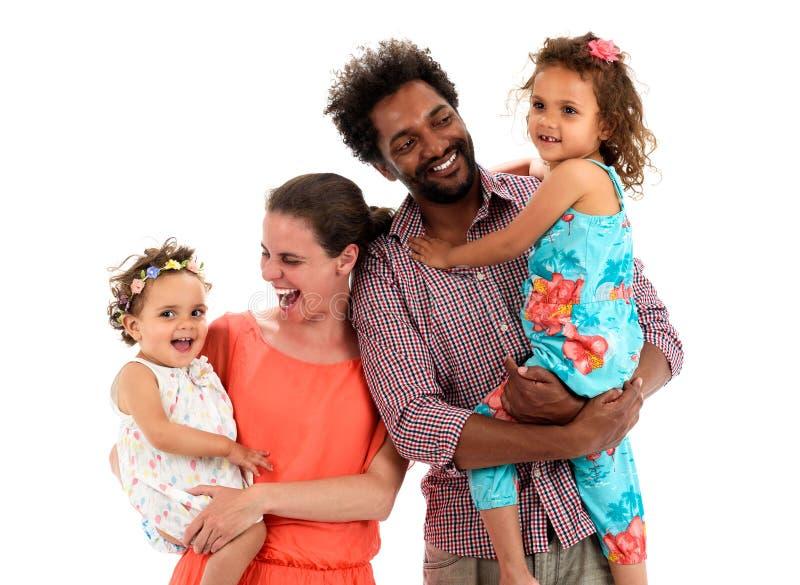 Familia interracial feliz aislada en blanco imágenes de archivo libres de regalías