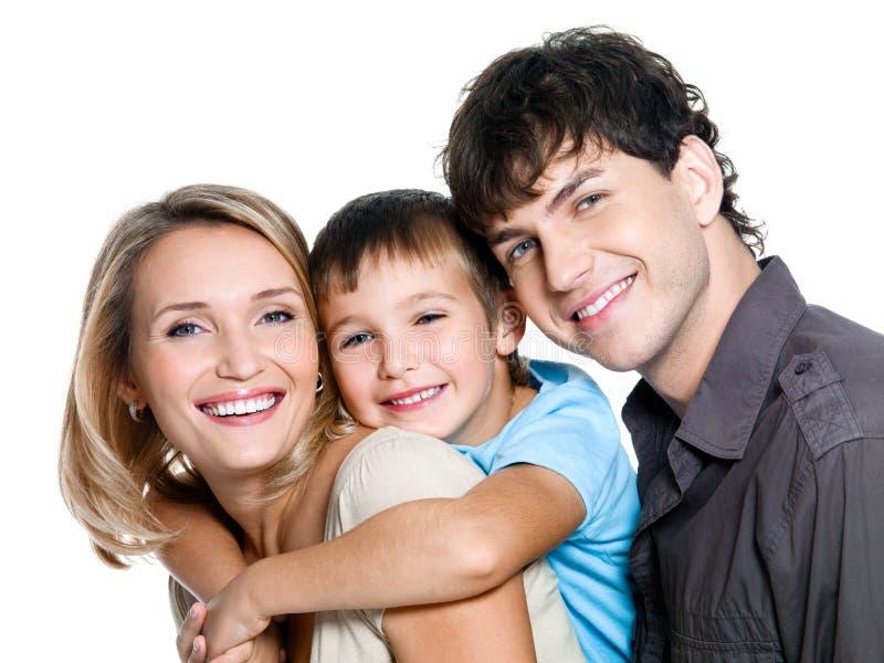 Familia joven feliz con el hijo imagen de archivo
