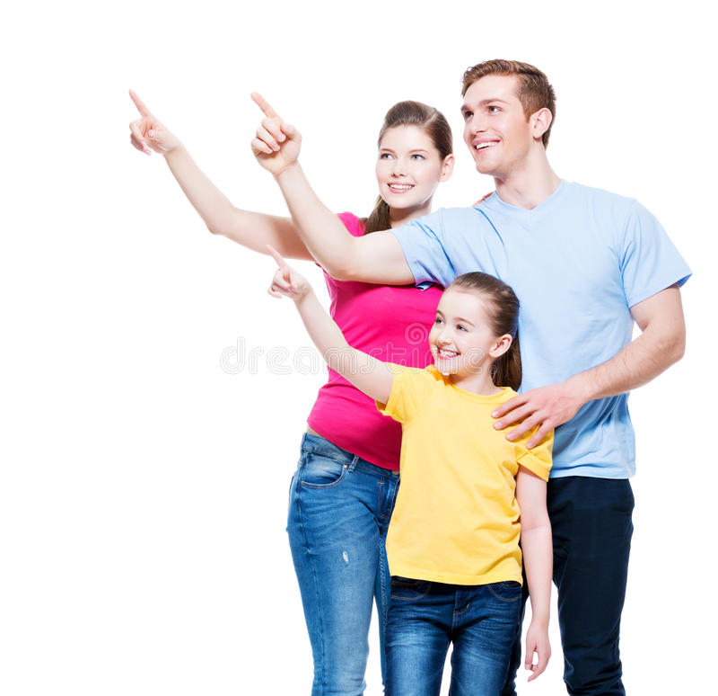 Familia joven feliz con el niño que destaca el finger fotografía de archivo