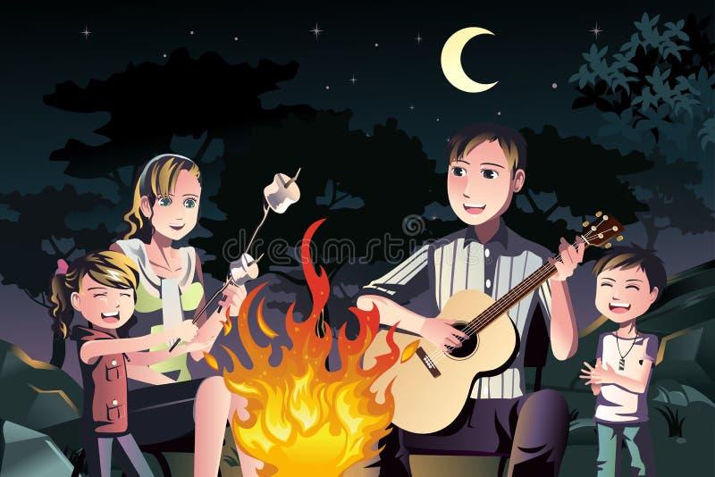 Familia que tiene una hoguera libre illustration