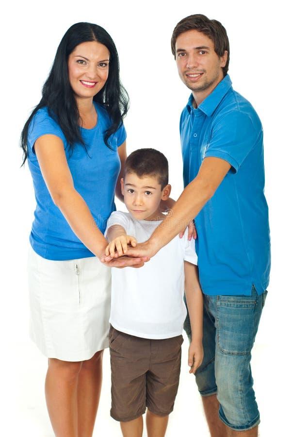 Familia unida con las manos en tapa fotografía de archivo libre de regalías