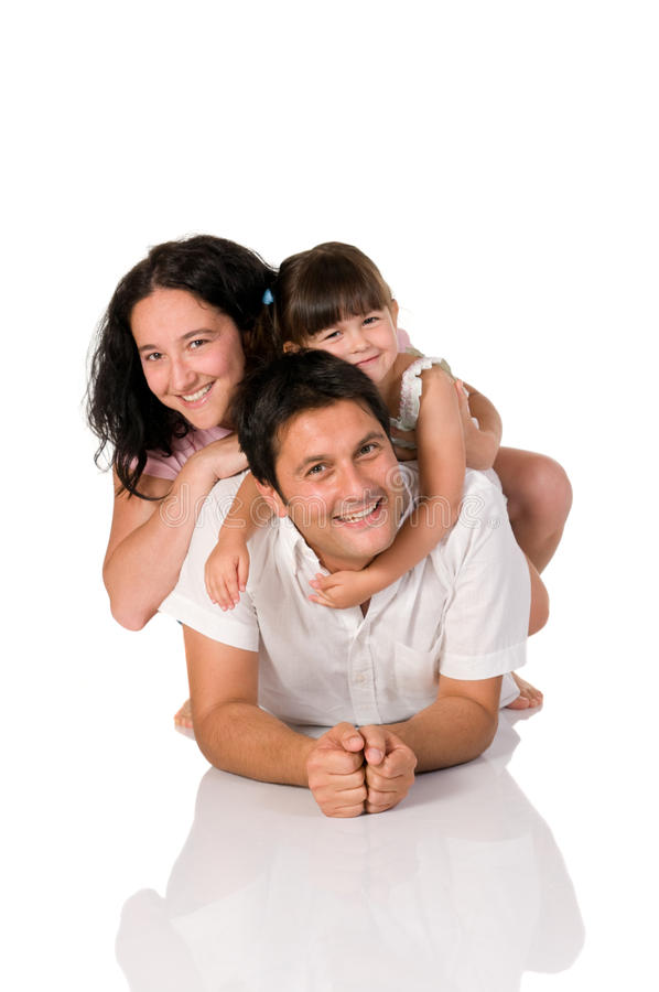 Familia verdadera feliz fotografía de archivo