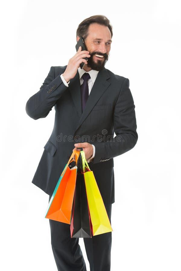 Familie altijd op zijn mening De bezige telefoon van de zakenmanbespreking koopt giften voor zijn familie Mens die familie roepen stock afbeeldingen