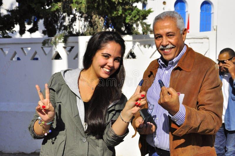 Familie die, Tunesië stemde royalty-vrije stock afbeelding