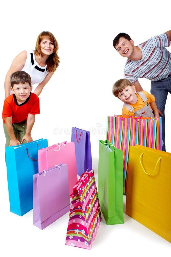 Familie en zakken stock fotografie