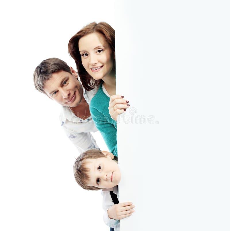 Familie heraus schauen stockbild