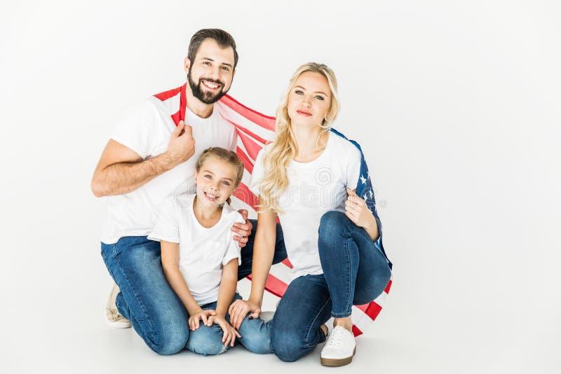 Familie met Amerikaanse vlag stock afbeelding