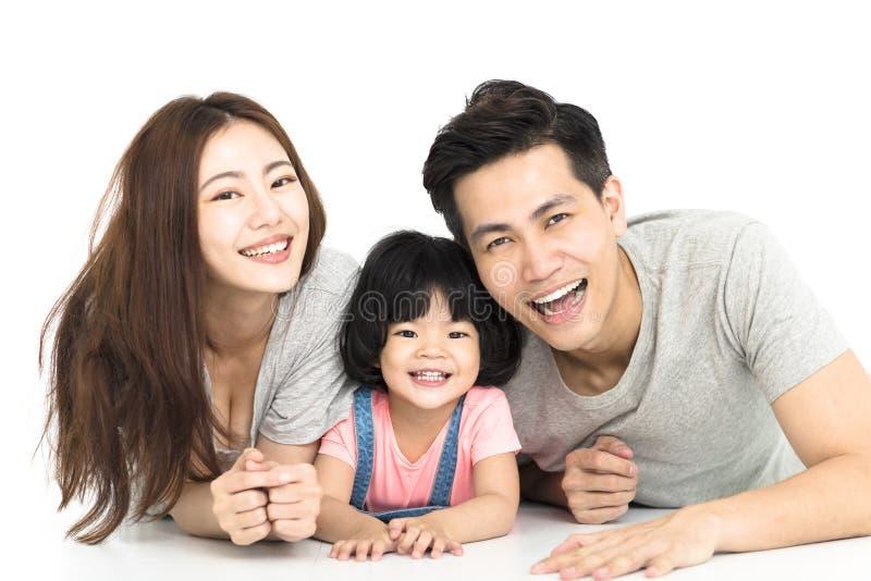 Familie met meisje het spelen op de vloer stock fotografie