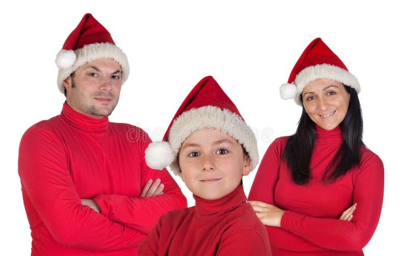 Familie mit roter Kleidung im Weihnachten lizenzfreie stockbilder