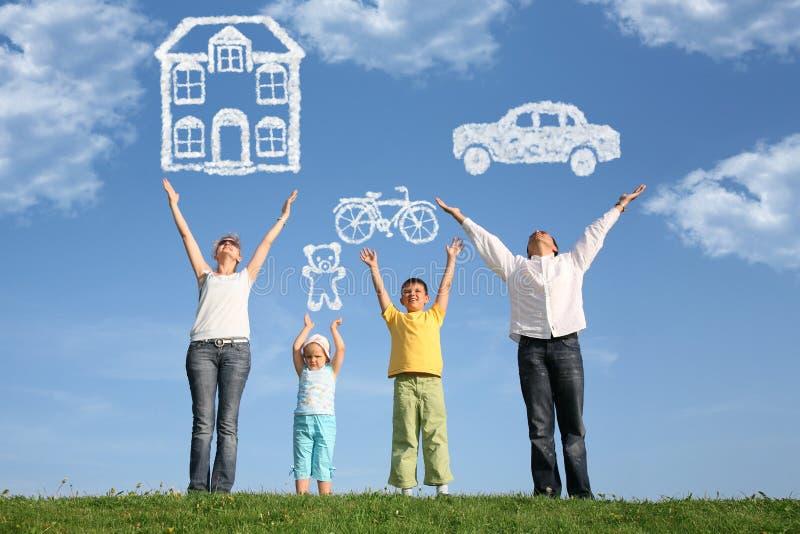 Familie op gras met handen omhoog en droom, collage royalty-vrije stock foto