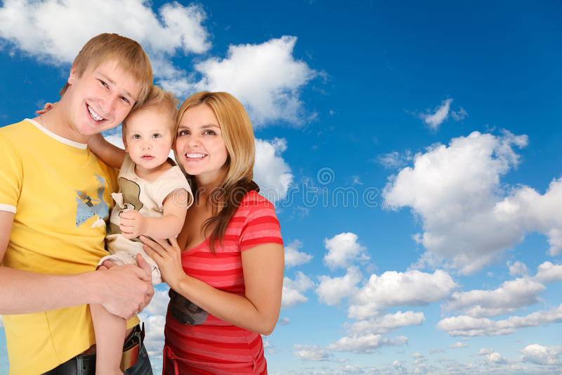 Familie op Witte wolken in blauwe hemelcollage stock afbeelding