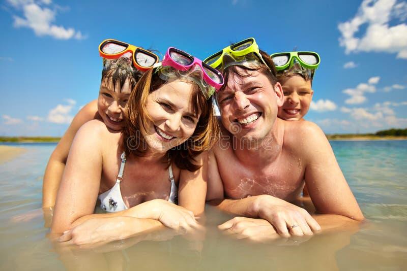Familie van duikers stock afbeeldingen