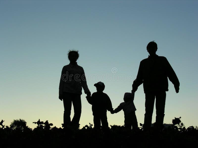 Familie van silhouet vier royalty-vrije stock afbeeldingen
