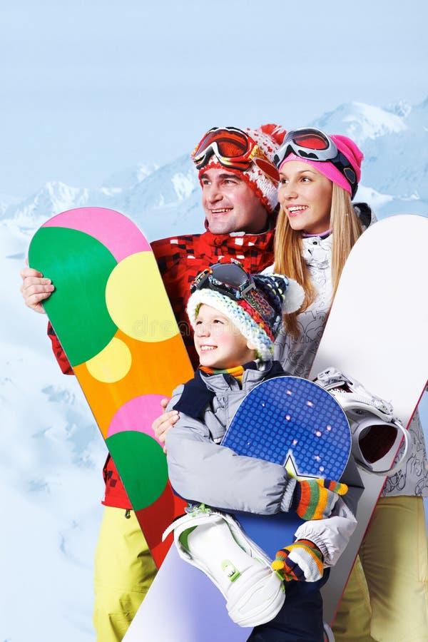 Familie van snowboarders stock afbeeldingen