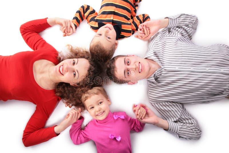 Familie van vier aanrakingenhanden stock afbeelding