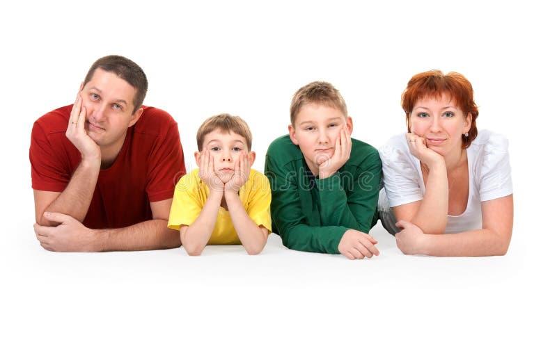 Familie van vier op de vloer stock afbeeldingen
