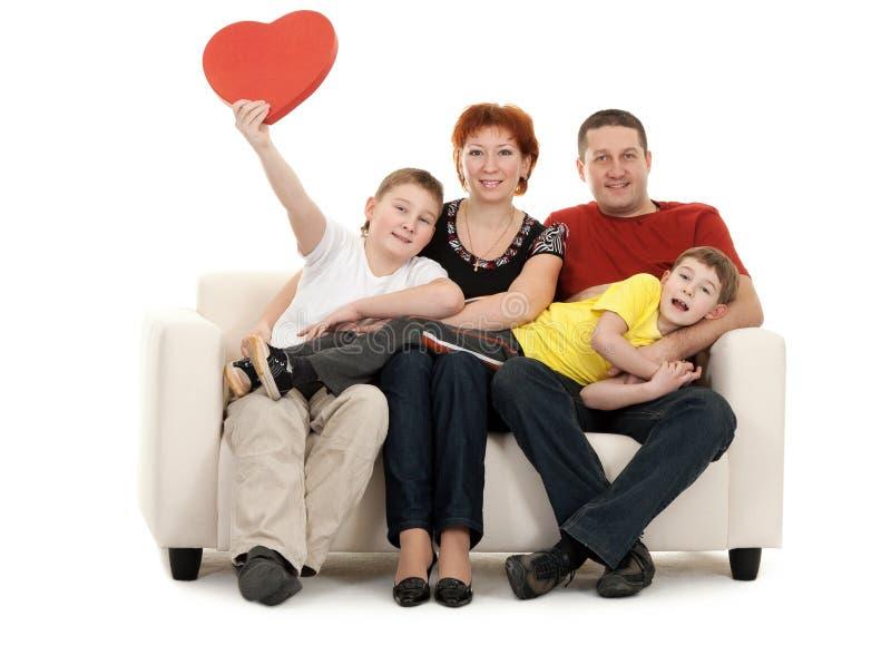 Familie van vier op een bank royalty-vrije stock foto