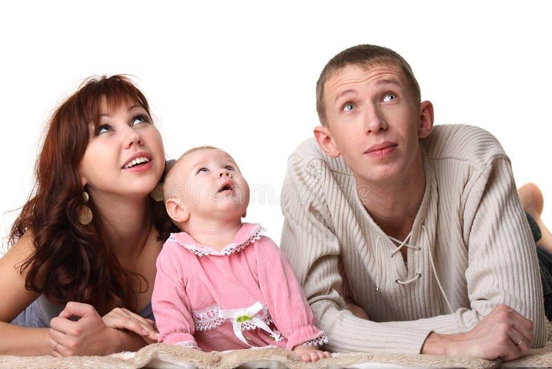 Familie - Vater, Mutter, Kind - schauen Sie oben stockfotografie