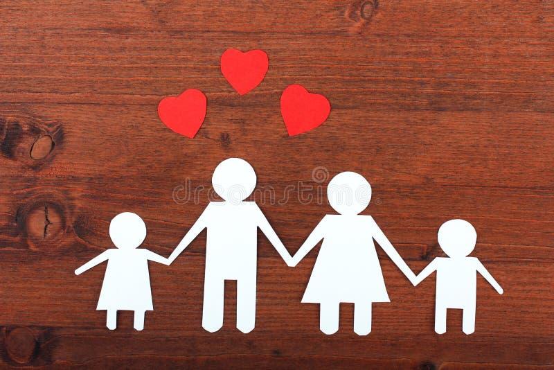 Familie vom Papier stockfotos