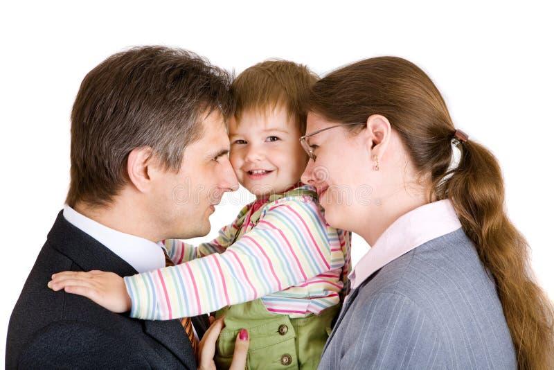 Familie von drei im Büro stockbild