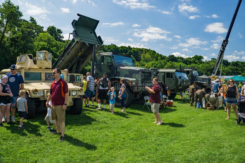 Families Enjoying the Military Hardware at the Annual Touch-A-Truck. Salem, VA – July 28th: Families enjoying the military hardware on display at the Annual royalty free stock photos